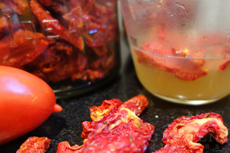 Dried tomatoes soaking in broth for tomato paste recipe