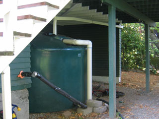 2500 gallon water tank hides under a deck