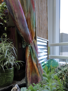 A Fishing Float Adds Unity Between a Seaside Succulent Garden & A Lush Tropical Space