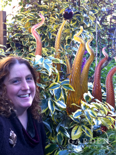 Barbara with her Glass art in Garden