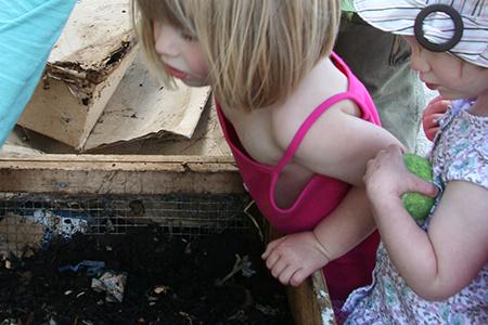 kids exploring vermicomposting